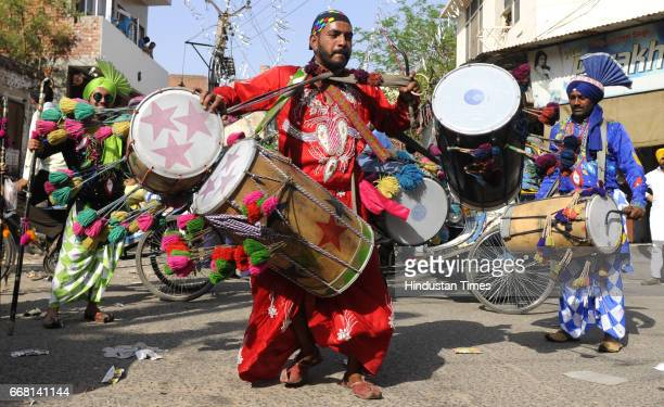Multi Tasker A Dholi playing 4 drums at a time in Nagar Kirtan on the occasion of Baisakhi festival on April 13 2017 in Patiala India Baisakhi is a...