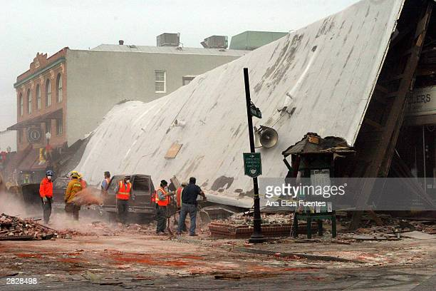 Multiagency crews clear away rubble on Park Street December 22 2003 in downtown Paso Robles California The 65 richter scale earthquake hit the...