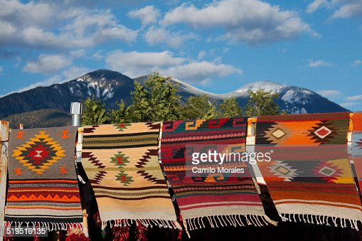 Multicolor blankets hanging near mountain