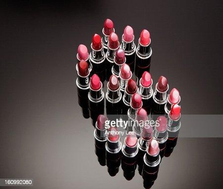 Multicolor lipsticks forming dollar sign : Stock Photo