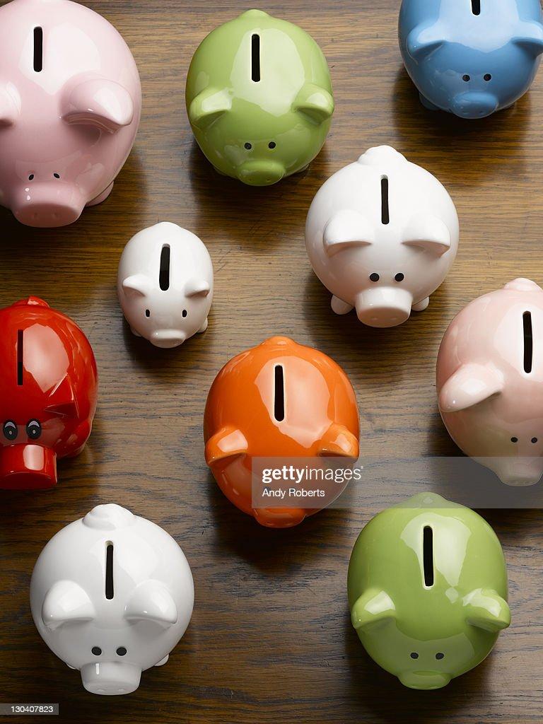 Multi-colored ceramic piggy banks : Stock Photo