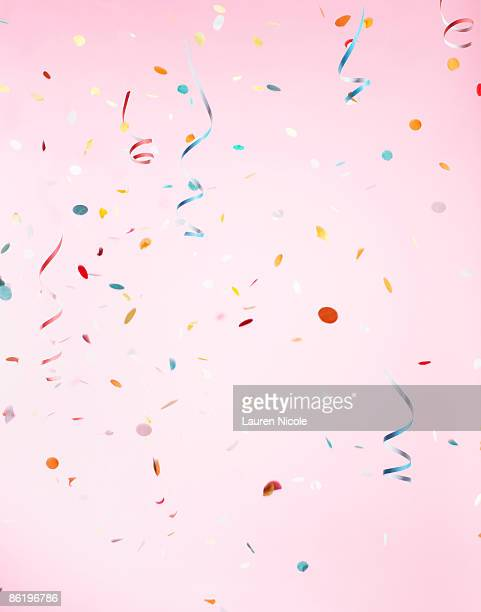 Multicolored Confetti on Pink Background