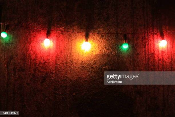 Multi-colored lights hanging on a wall