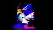 Multicolored lights on a woman's face