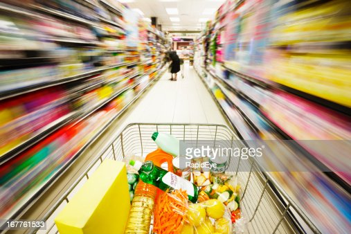 Multicolored motion blur streaks show speed of racing shopping cart