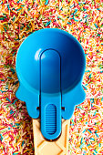 Multicolored Pastel background or colorful texture with top view. Pastel tasty fluffy sweet mini marshmallows. Minimal summer holiday style. Blue ice-cream Spoon and plastic cocktail ducts
