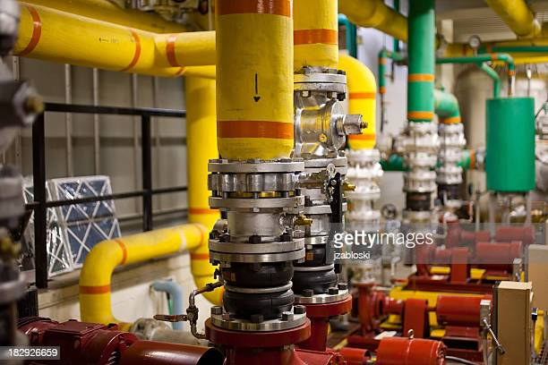 Multicolored pipes in a boiler room