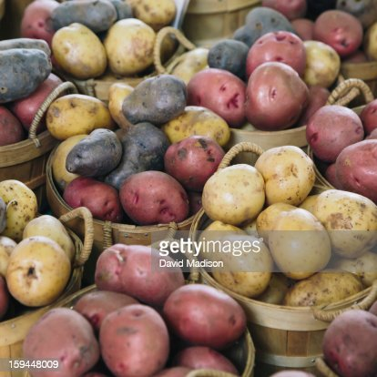 Multi-colored potatoes at farmers' market : Stock Photo