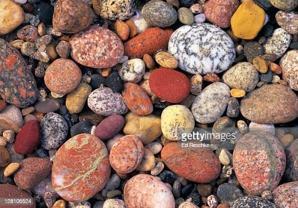 Multicolored Rocks. Lake Superior Shoreline, Pictured Rocks National Lakeshore, Michigan. Twelve Mile Beach. Stones include polished granite and quartz rounded like eggs.