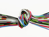 Multi-colored wires tied in knot