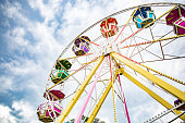 Multicolour ferris wheel on blue sky background. Copy space