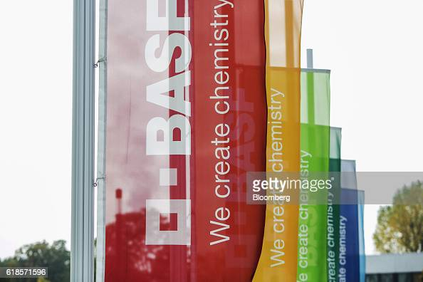 Multicoloured banners fly outside the BASF SE headquarters following a news conference to announce the company's third quarter earnings in...
