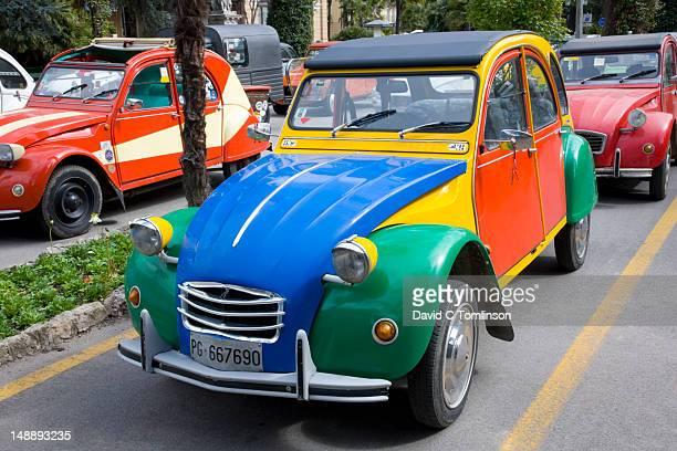 Multi-coloured car at Citroen 2CV rally.
