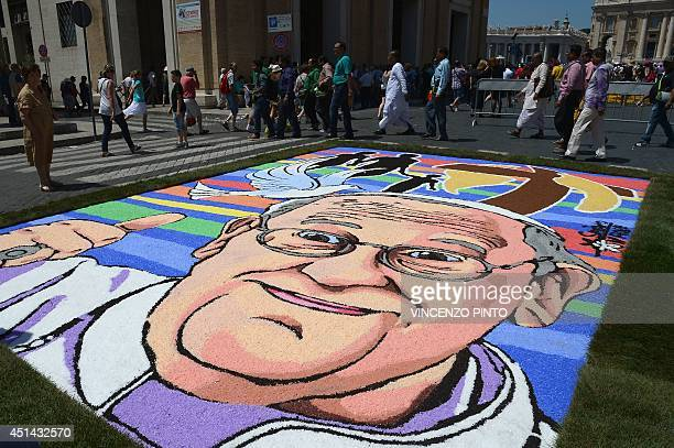 A multicoloured flower carpet shows a portrait of Pope Francis during the historic 'infiorata' which display carpets featuring half a million flowers...