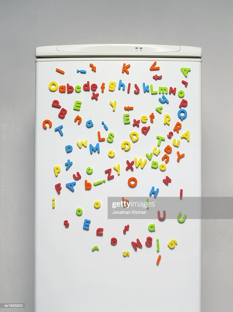 Multicoloured Magnets on a Fridge Door : Stock Photo