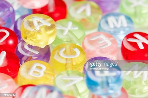 Alfabeto d'informazione in plastica con lettere individuali perline