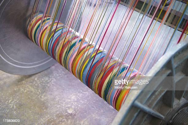 Multicoloured silk yarn on industrial loom in textile mill