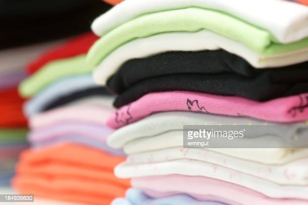 Multicoloured stack of clothes - focus on foreground