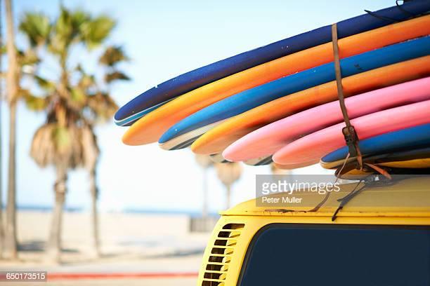 Multi-coloured surfboards tied onto vehicle, Venice Beach, Los Angeles, USA