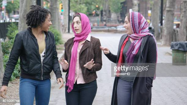 Multi-Cultural Female Friends Walk in the City