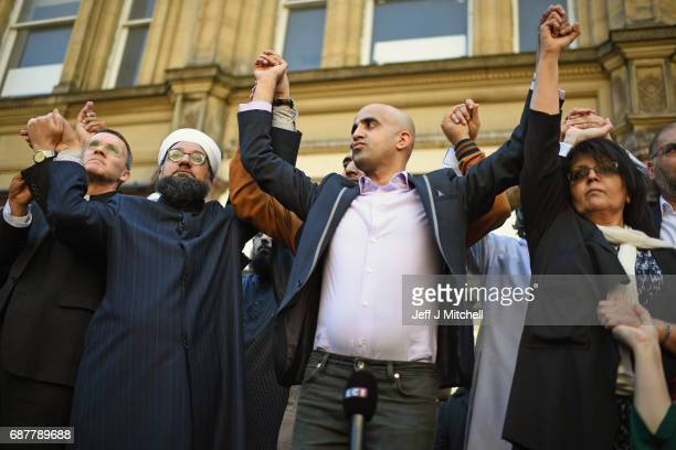 Multicultural religious leaders from across Manchester hold a vigil in St Ann's Square on May 24 2017 in Manchester England An explosion at...