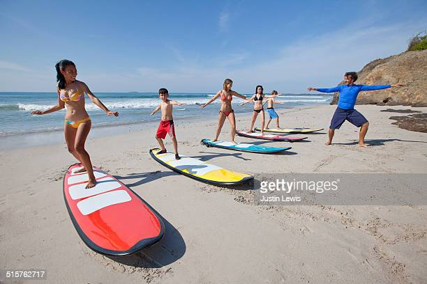 Multicultural Teens Learning to Surf, Beginners