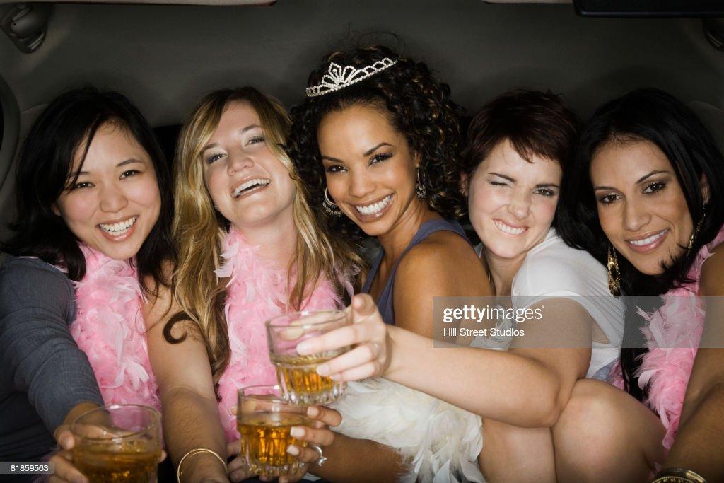 Multi-ethnic bachelorette party holding drinks : Stock Photo