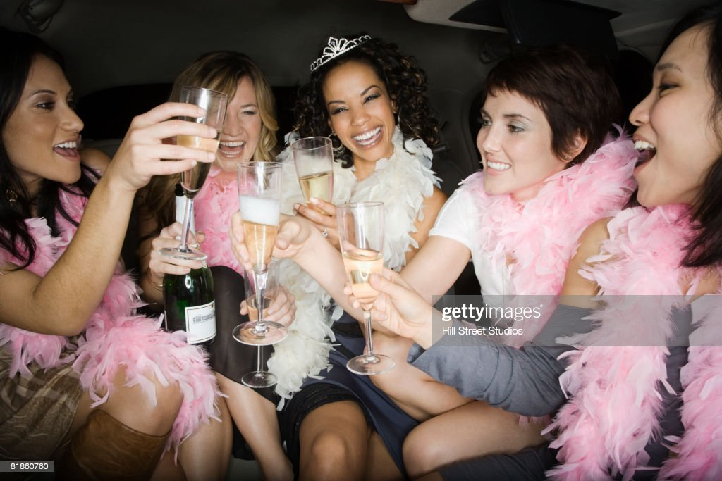 Multi-ethnic bachelorette party toasting with champagne : Stock Photo