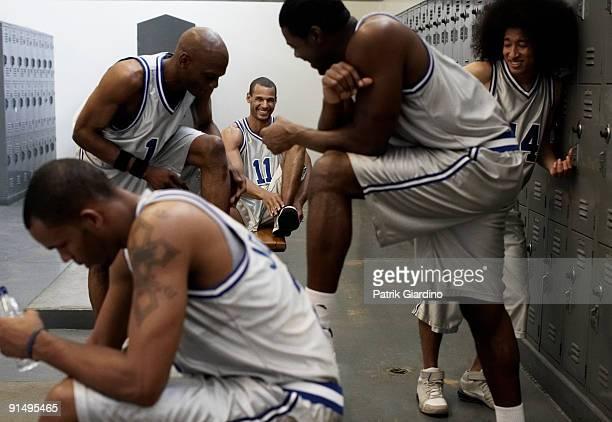 Multi-ethnic basketball players dressing in locker room