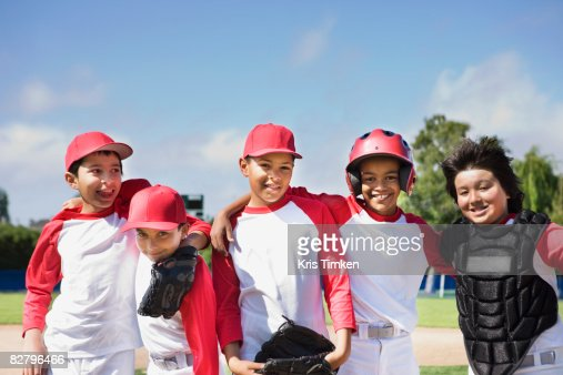 Multi-ethnic boys in baseball uniforms : Stock Photo