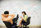 Multi-ethnic business people brainstorming on whiteboard