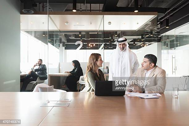 Multi-ethnic business people discussing in office