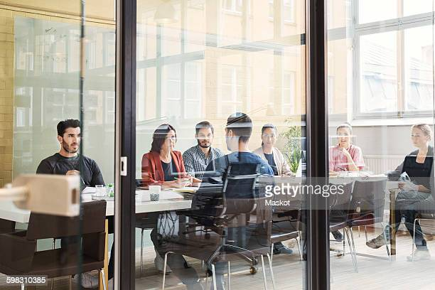 Multi-ethnic business people having discussion in conference room