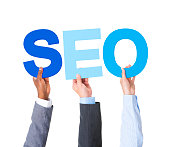 Multiethnic Business People Holding the Word Forming SEO