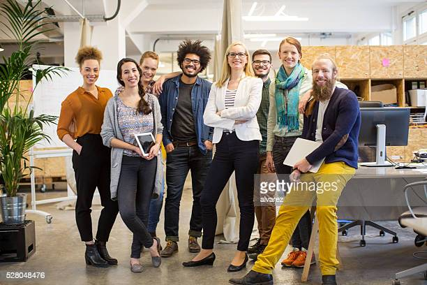 Multi-ethnic business people smiling in office