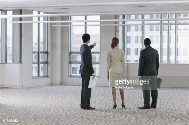 Multi-ethnic business people viewing empty building