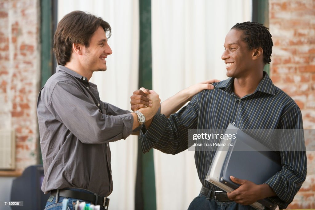 Multi-ethnic businessmen greeting each other
