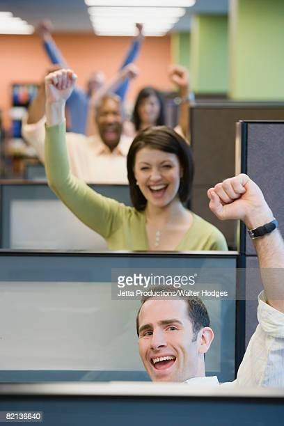 Multi-ethnic businesspeople cheering