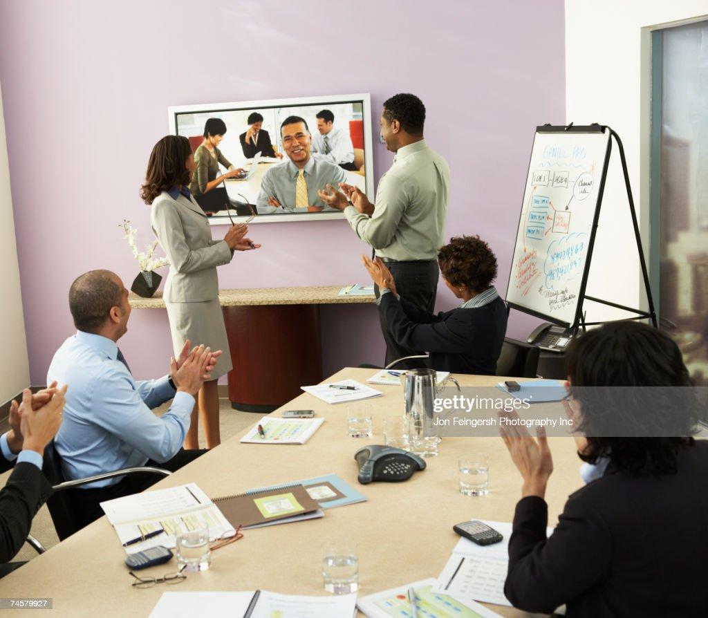 Multi-ethnic businesspeople having video conference : Stock Photo