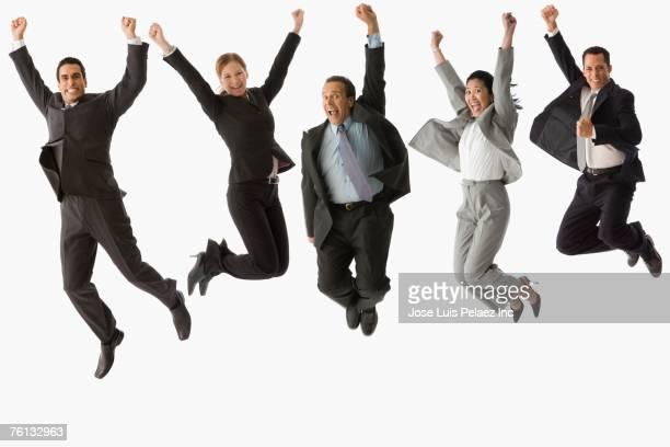 Multi-ethnic businesspeople jumping