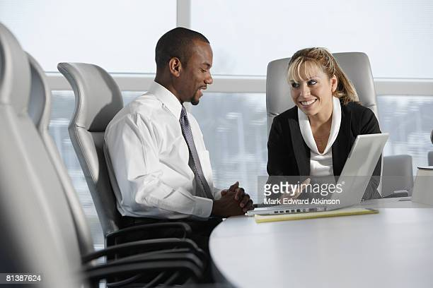 Multi-ethnic businesspeople talking