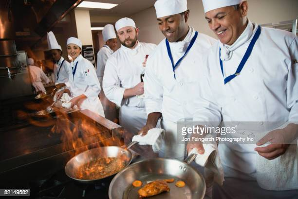 Multi-ethnic chefs preparing food