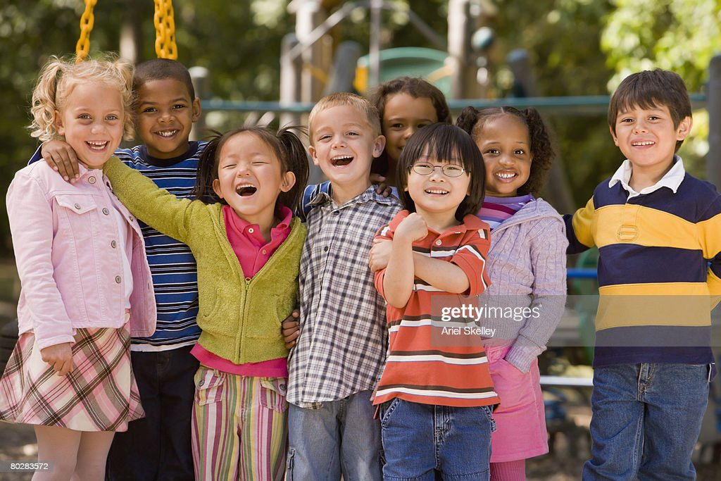 Multi-ethnic children at playground : Stock Photo