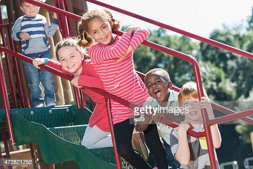 Multi-ethnic children having fun at playground