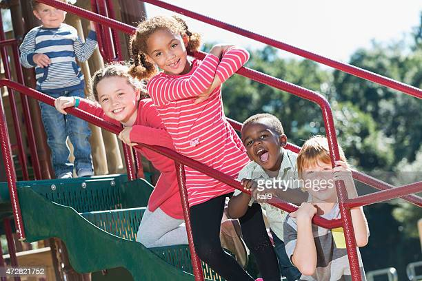 Multi-ethnic children having fun at playground