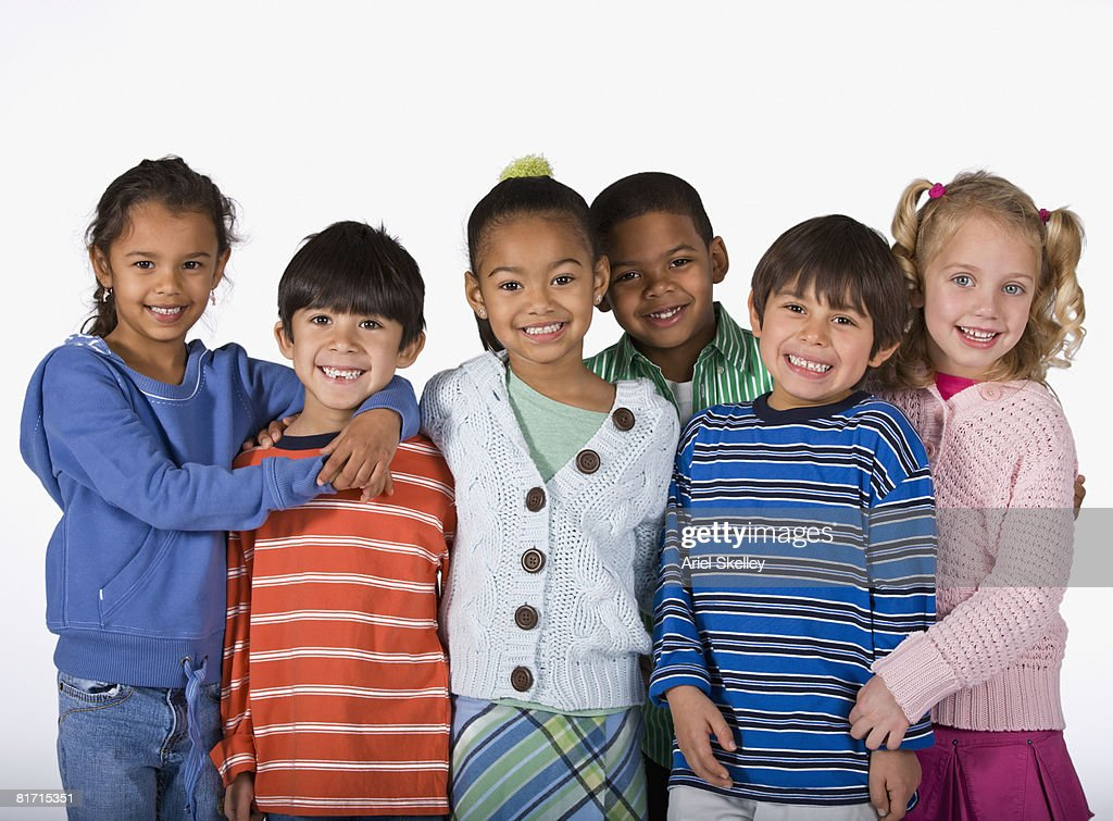 Multi-ethnic children hugging : Stock Photo