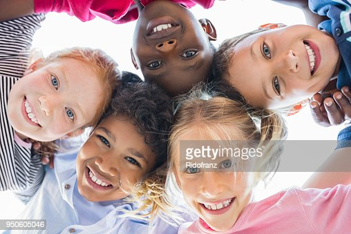 Multiethnic children in a circle : Stock Photo