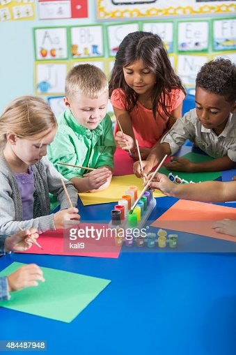 Multi-ethnic children in kindergarten doing art project