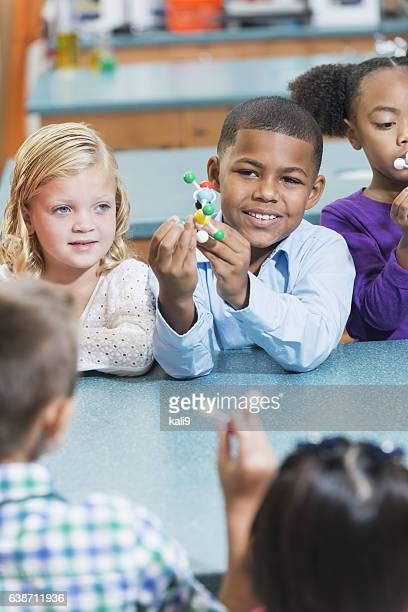 Multi-ethnic children in science class