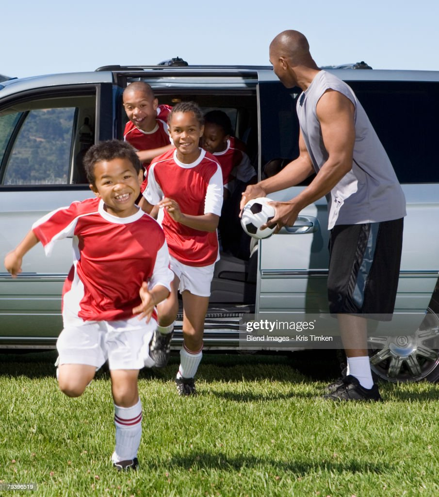 Multi-ethnic children in soccer uniforms